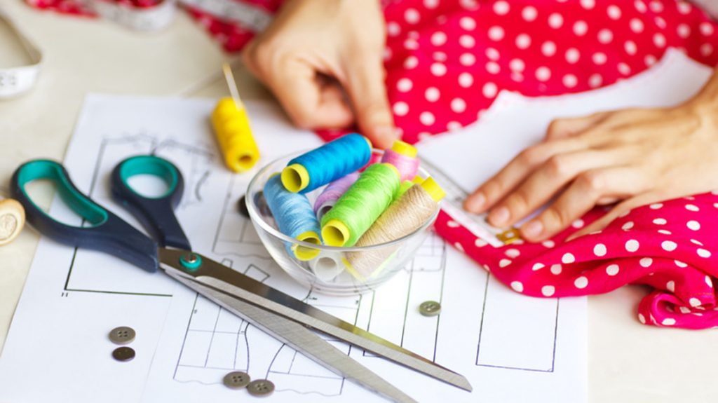 A tailor is laying out a dress/Sewing layout. Soft focus